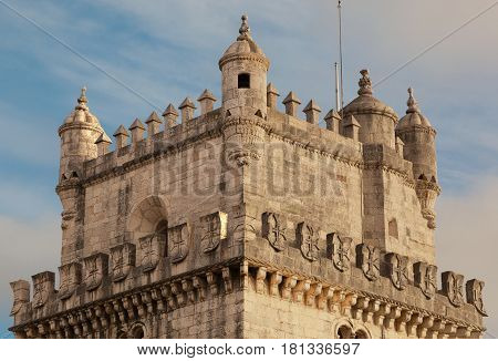 Top part of Torre de Belem Belem Tower in Lisbon Portugal. Showing the top section with a blue sky in the background. With space for text.