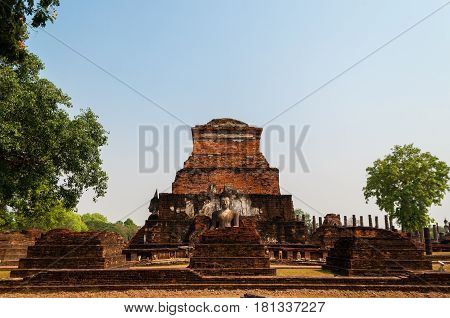 Buddha statue and ancient ruin in Thailand. The temple named Wat Mahathat part of Sukhothai historical park ancient kingdom in thirteenth centuries.