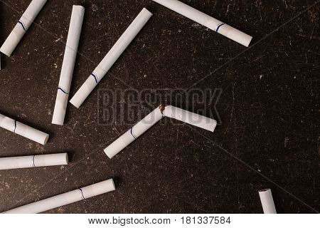 Addiction to cigarettes on a dark marble background. Bad habit. Care for health. Leave off smoking. Smoke addiction. Addiction concept