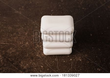 hygiene with soap. White soap on a dark marble background. Personal care. Hygiene. To observe hygiene