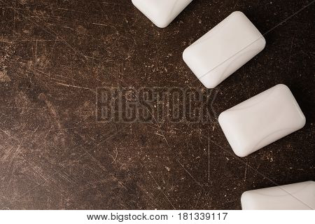 White soap on a dark marble background. Personal care. Hygiene. Soap concept. Soap on table