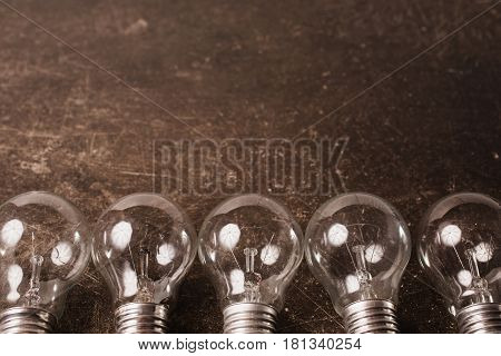 Light bulb lamp on a dark marble background. To save energy. Eco light lamp concept. Incandescent lamp