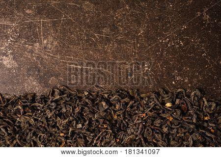 Green tea on a dark marble background. Healing drink. Healing beverage. Beverage from tea leaves.