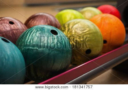 Colored bowling balls. Games and entertainment with friends. Sports equipment. Play bowling