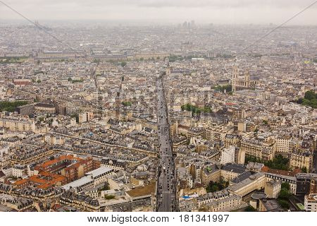 View of the streets of Paris from the heights. Travel through Europe. Attractions in France. Cloudy Paris. Clouds in the sky. Urban district. Suburban district. Commercial district. Residential district