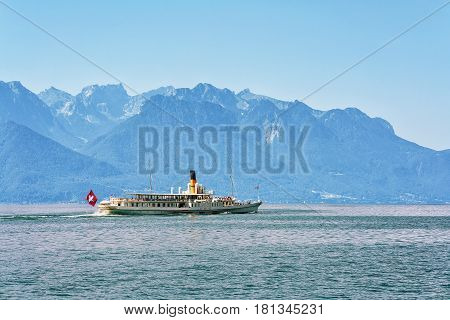 Montreux Switzerland - August 27 2016: Excursion ship with people aboard at Geneva Lake in Montreux Vaud canton Switzerland