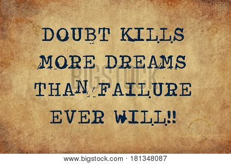 Inspiring motivation quote of doubt kills more dreams than failure ever will with typewriter text. Distressed Old Paper with Typing image.