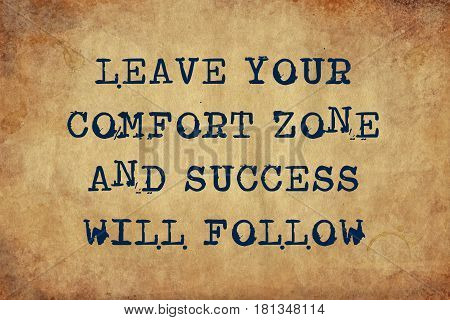 Inspiring motivation quote of leave your comfort zone and success will follow with typewriter text. Distressed Old Paper with Typing image.