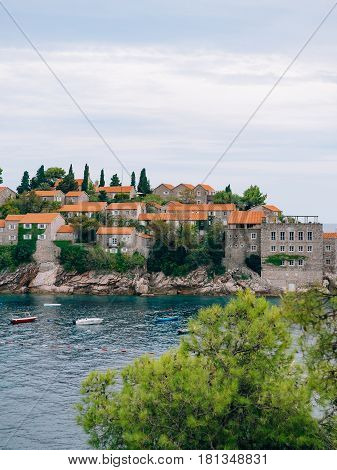 Island of Sveti Stefan close up at sunset. Montenegro, the Adriatic Sea, the Balkans.