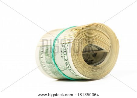 Twisted bundle 100 dollar bills isolated on white.