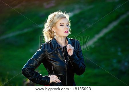 Beautiful young woman on leather jacket. Punk, rock style fashion