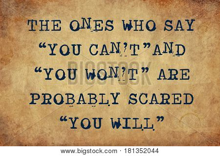 Inspiring motivation quote of the ones who say can't and you won't are probably scared you will with typewriter text Turn Knowledge into Action. Distressed Old Paper with Typing image.
