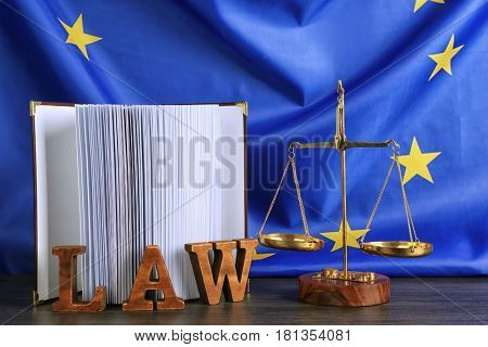 Justice scales and book on European Union flag background