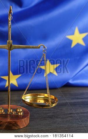 Scales on European Union flag background