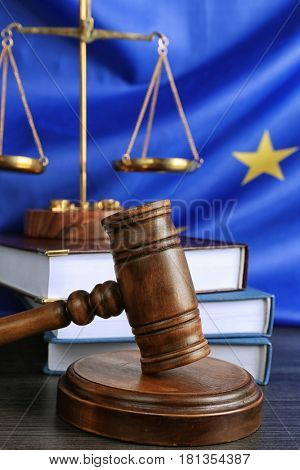 Judge gavel and books with scales on European Union flag background