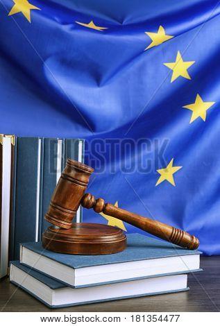 Judge gavel and books on European Union flag background