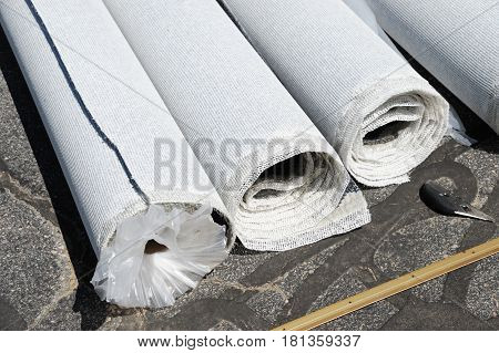 carpet roll and carpet installation on the ground