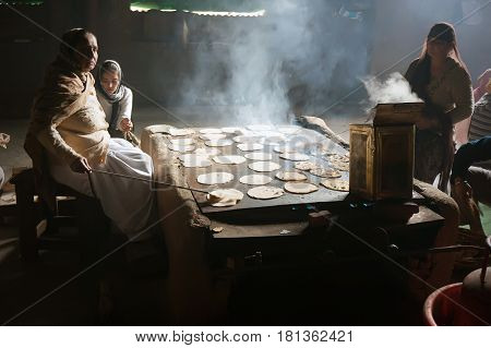 In The Kitchen Of The Golden Temple, Women Cook, Chapati - Traditional Indian Bread.