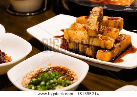 Chinese dessert - glutinous rice deep fried with caramel and crane sugar