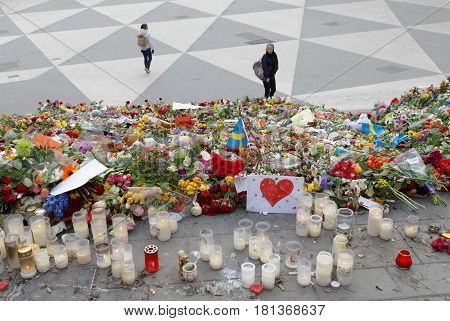 STOCKHOLM SWEDEN - APR 12 2017: Lots of flowers and candles in central Stockholm from people paying respect to the victims in the terror attack in Stockholm April 07 2017. April 13 2017 in Stockholm Sweden