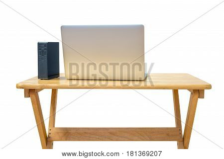 External hard drive and laptop on office desktop isolated on white. This has clipping path.