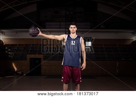 Basketball Player Holding Ball In One Hand