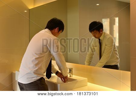 An Asian Man Washing Hands In Bathroom, Luxury Restroom, Person