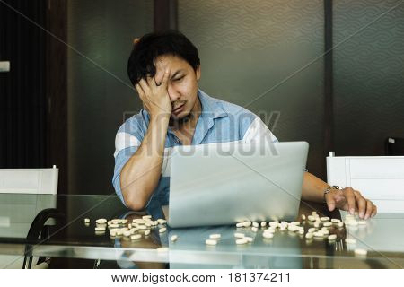 Tired Asian Man Tired Of Working In Office With Medicines On Table, Person