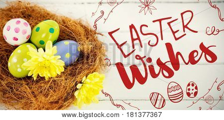 Happy Easter red logo against a white background against painted easter eggs in nest