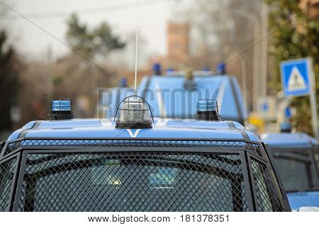 convoy with several police cars and armored vehicles on patrol to prevent terrorist attacks in the city
