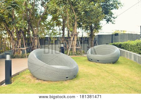 Relaxing Rattan Sofa in a garden outdoor object