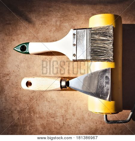 A Brush And A Paint Spatula.