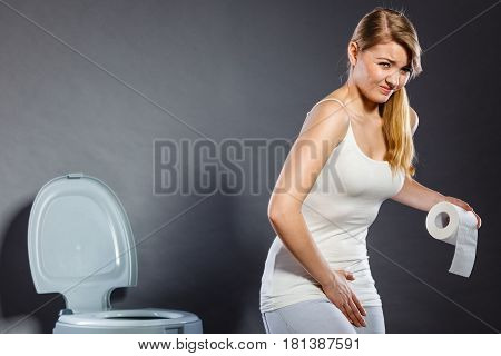 Woman With Hands Holding Her Crotch In Toilet
