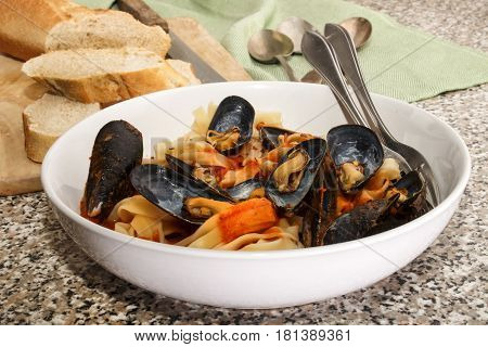 mussels with tagliatelle tomato sauce and baguette