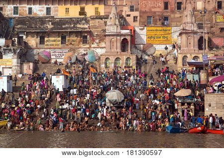 Crowds Of People The Stairs Of The Embankment Of The River Ganges, Varanasi, India.