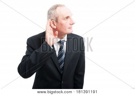 Portrait Of Elegant Senior Making Can't Hear You Gesture