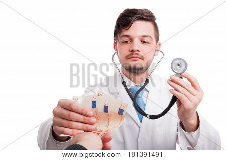 Patient Is Giving Money To A Doctor