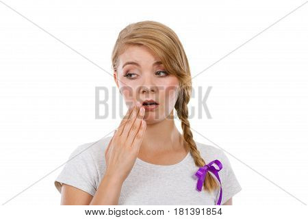 Upset Teenage Woman With Hand Close To Lips