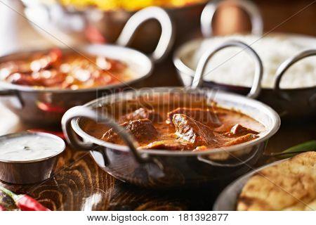indian curry in balti dish, lamb tikka masala