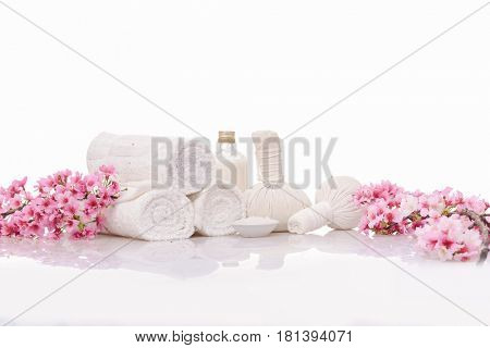Spa concept with lilac flowers on old wooden . Spa. Spa treatment. Spa massage.