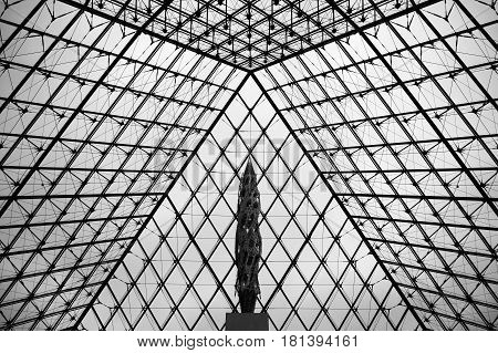 The Louvre Pyramid taken from the bottom on October 10 2012 in Paris France. It serves as the main entrance to the Louvre Museum. Completed in 1989 it has become a landmark of Paris.