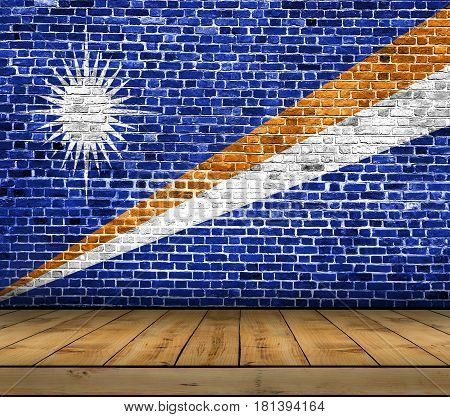 Marshall Islands flag painted on brick wall with wooden floor