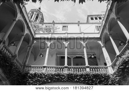 BARCELONA, SPAIN - JULY 12, 2016: Barcelona (Catalunya Spain): courtyard of the historic Palace of Lloctinent in the gothic quarter. Black and white