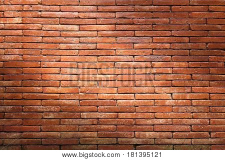 Brick wall texture, brick wall background for interior or exterior design with copy space for text or image. Dark edged.