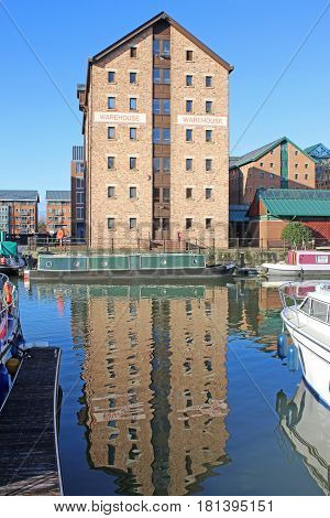 Victorian warehouse reflected in Gloucester Docks canal