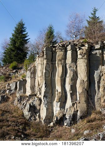 Old and abandoned basalt quarry in the Ore Mountains - basalt columnar jointing