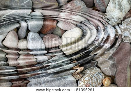 Abstract image of the water ripples over the stone pebbles - digitally altered