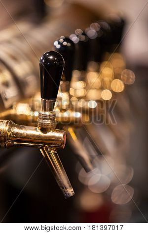 Lot of vintage Golden beer taps at the bar