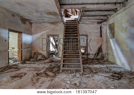 Stairs in old, abandoned and crumbling building