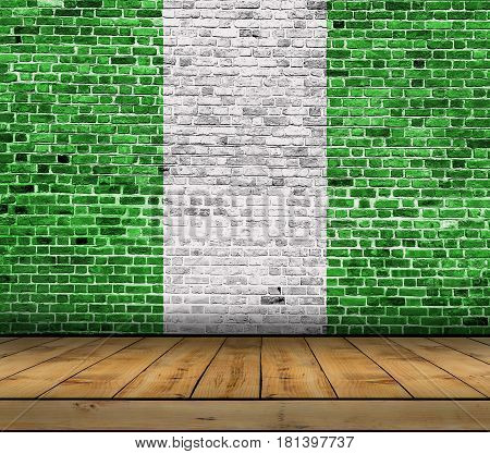 Nigeria flag painted on brick wall with wooden floor
